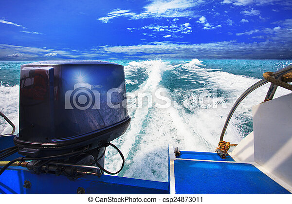 rear view from speed boats running against clear sea blue water - csp24873011