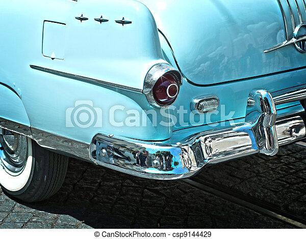 Rear view of a vintage car fin closeup. blue - csp9144429