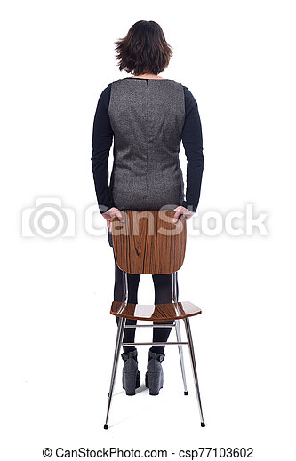 rear view of a woman with a chair in white background - csp77103602