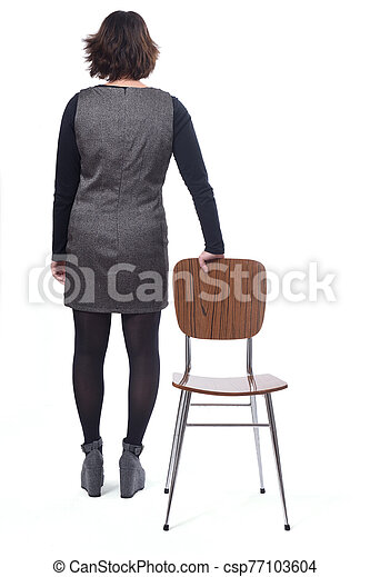rear view of a woman with a chair in white background - csp77103604