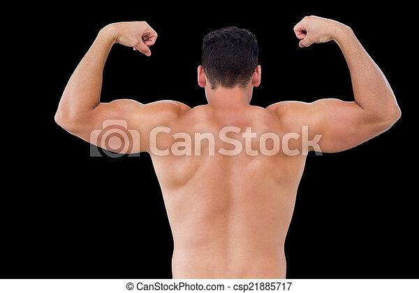 Rear view of shirtless muscular man flexing muscles - csp21885717