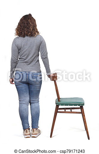 rear view of woman playing with a chair in white background - csp79171243