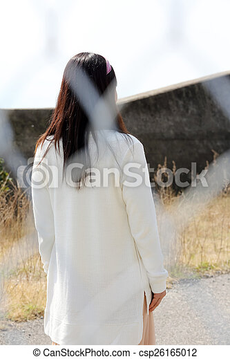 Rear view of young woman - csp26165012