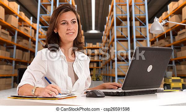 Receptionist at distribution warehouse b - csp26591598