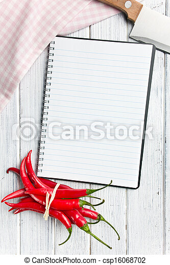 recipe book with chili peppers - csp16068702