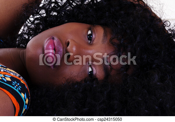 Reclining Portrait Attractive African American Woman - csp24315050