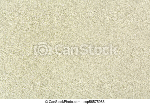 Recycled paper texture background in light cream sepia color ton