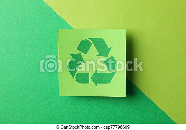 Recycling sign on two tone background, top view - csp77798609