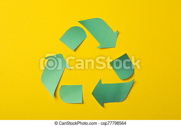 Recycling sign on yellow background, top view - csp77798564