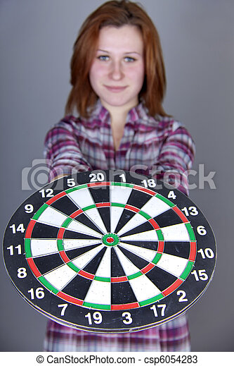 Red-ahired girl with darts. - csp6054283