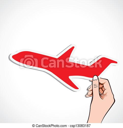 red airplane sticker in hand - csp13083187