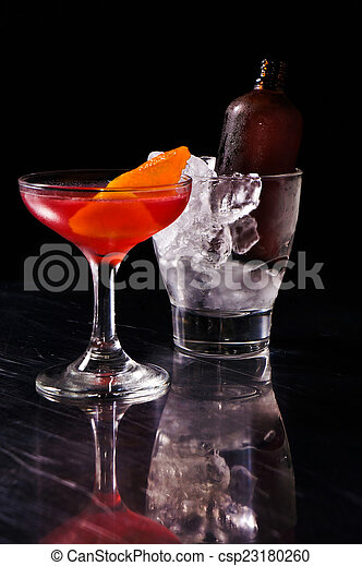 Red alcoholic summer cocktail - csp23180260