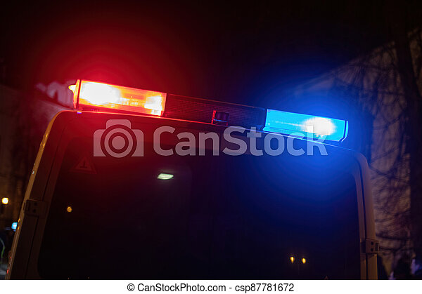 Red and blue light flasher atop of a police car - csp87781672