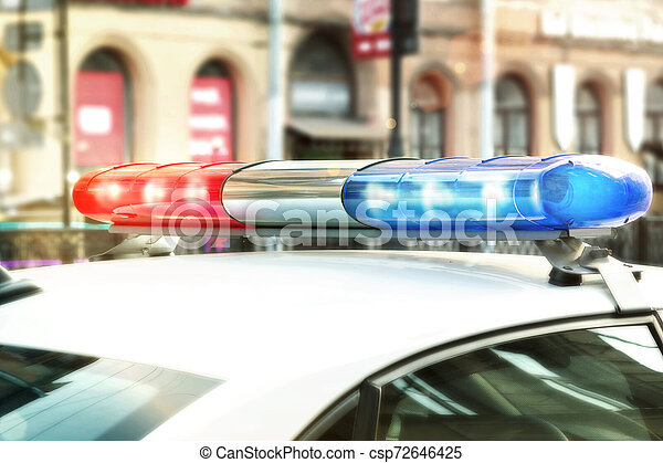 Red and blue signal lights on the roof of a traffic police patrol car - csp72646425