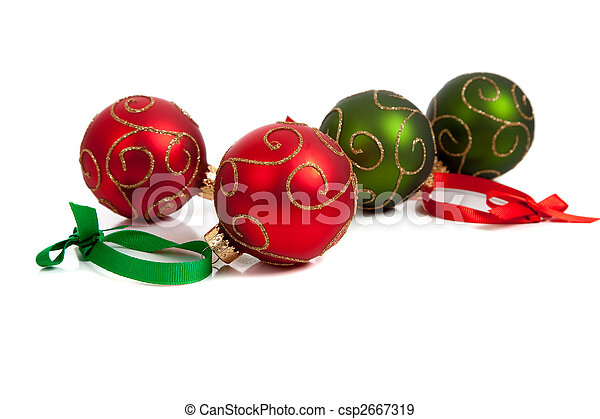 red and green christmas ornaments with ribbon on white csp2667319