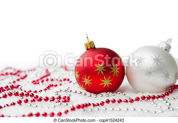 red and silver christmas decorations with snow isolated on white background copy space xmas