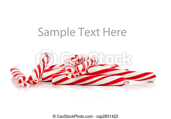 Red and white candy canes on white with copy space - csp2831422