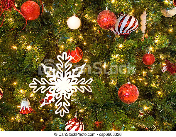 red and white christmas ornaments on a green tree with white lights csp6608328 - Christmas Tree With White Lights And Red Decorations