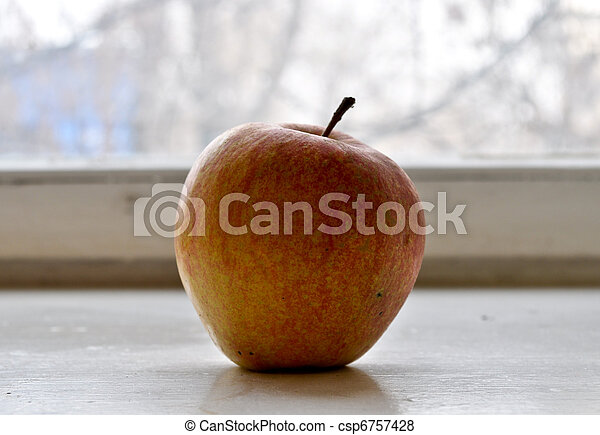 Red apple on a window sill - csp6757428