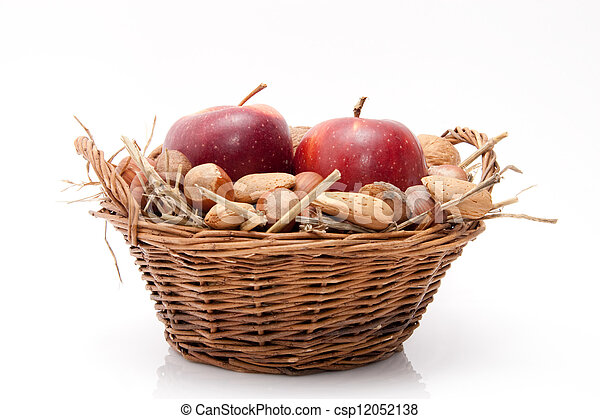red apples and nuts in a basket on white background - csp12052138