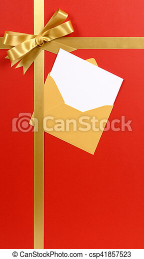 Red Background Gold Christmas Gift Ribbon Bow With Blank Invitation Or Greetings Card Vertical