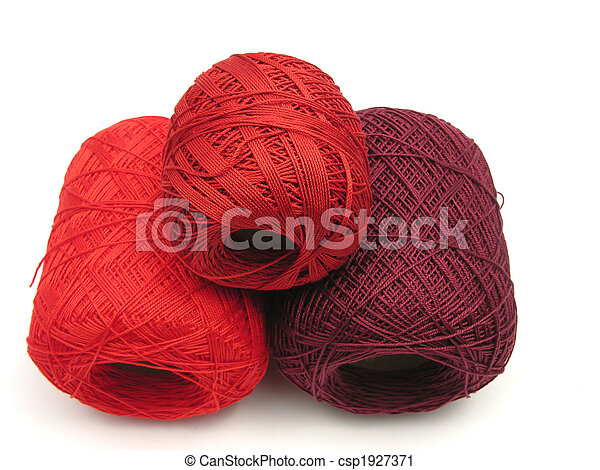 Red balls of wool on a white background - csp1927371
