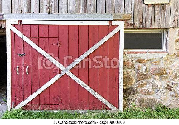 Partially Open Red Barn Door In A Weathered Barn Stock Image