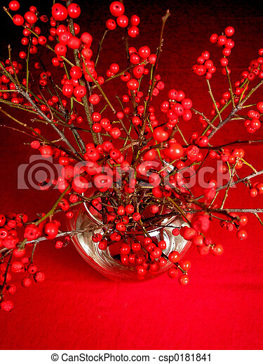 Red Berry Tree Branches In A Vase On Red Tablecloth