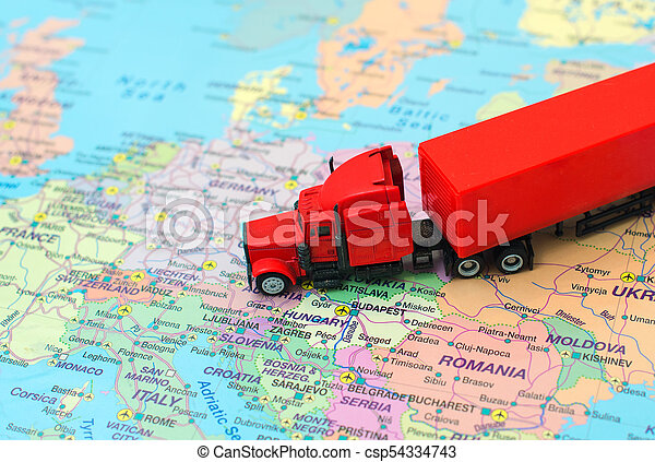 Red big cargo truck on the map of Europe. Map Cargo on
