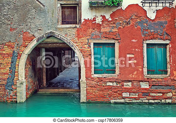 Red brick house and small canal in Venice, Italy. - csp17806359