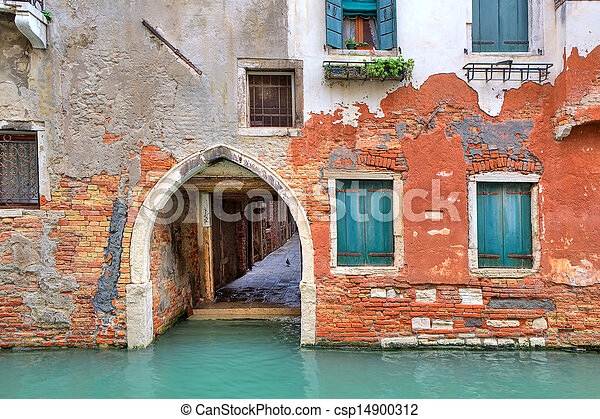 Red brick house on small canal in Venice, Italy. - csp14900312