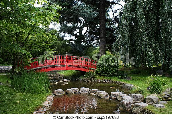 Red bridge in a japanese garden - csp3197638