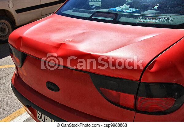 red car full of dents on the sheet - csp9988863