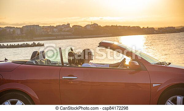 Red car on the beach. - csp84172298
