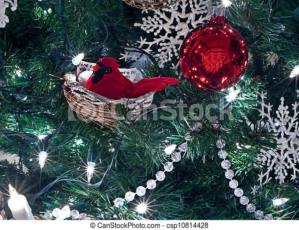 red cardinal bird christmas ornamnet in tree csp10814428
