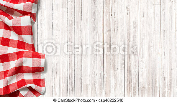 Red Checkered Picnic Tablecloth On Subtle Wood Table   Csp48222548