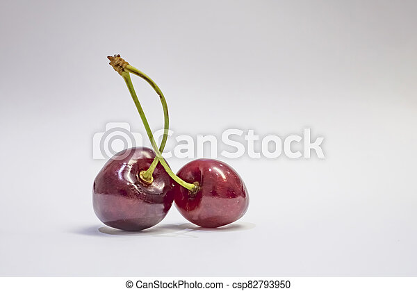 red cherries on a white background - csp82793950
