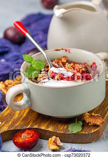 Red cherry plum crumble for healthy breakfast. - csp73020372