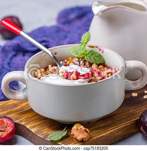 Red cherry plum crumble for healthy breakfast. - csp75183205