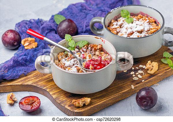 Red cherry plum crumble with walnut crumb. - csp72620298