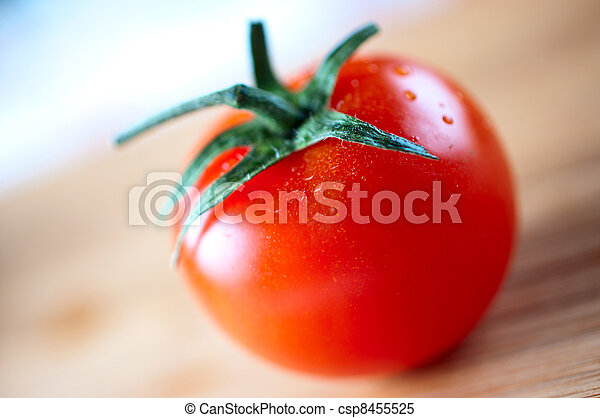 Red cherry tomatoes on a cutting board - csp8455525