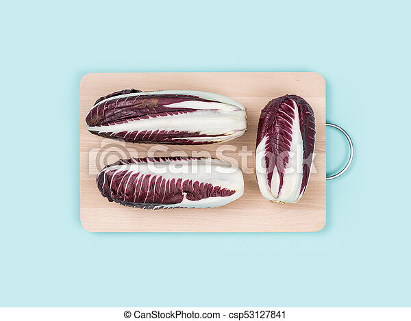 Red chicory on a chopping board - csp53127841