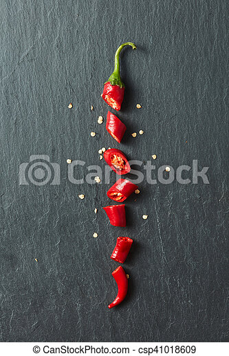 Red chili pepper cut into slices - csp41018609