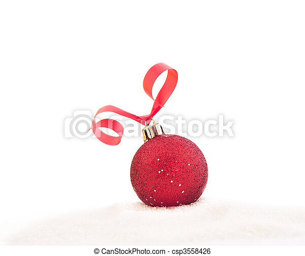 Red Christmas ball with a ribbon on snow - csp3558426