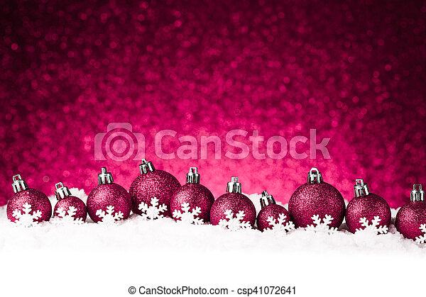 red christmas balls on snow - csp41072641