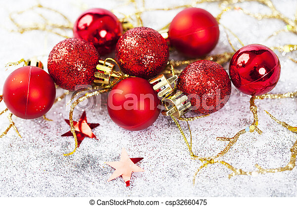 Red Christmas balls on sparkling silver background - csp32660475