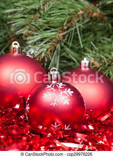 Red Christmas Balls Tinsel Close Up And Xmas Tree Vertical