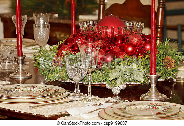 Red Christmas Centerpiece on Formal Dining Table - csp9199637