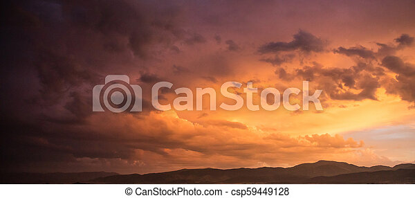 Red cloudy sky at sunset, mountain range, banner, copy space, wallpaper. - csp59449128