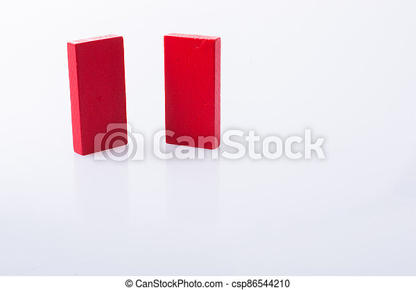 Red color domino blocks on white background - csp86544210